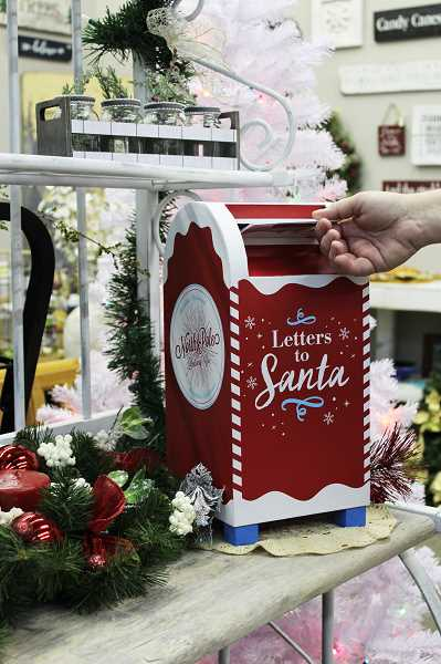 HERALD PHOTO: KRISTEN WOHLERS - Santa letters can be dropped into the mailbox at 181 N. Grant St. Ste 101.