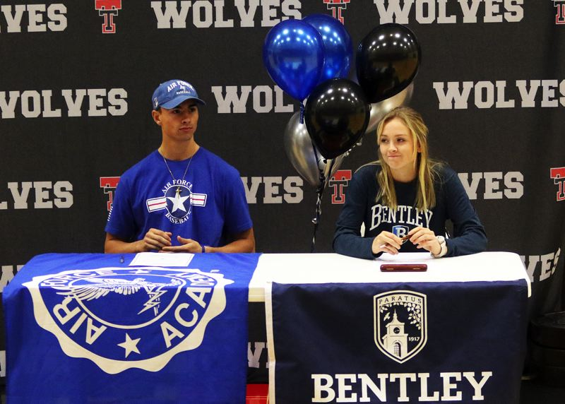 DAN BROOD - Tualatin High School seniors Kaden Cook (left) and Ella Hillier signed the national letters of intent during a ceremony at the school.