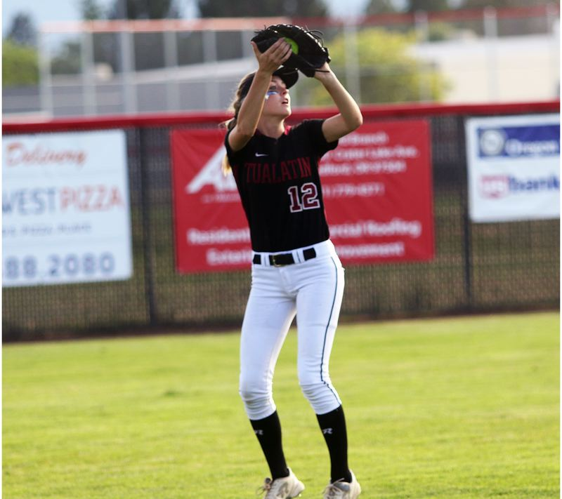 DAN BROOD - Tualatin senior Ella Hillier makes a catch in the outfield during the Wolves' state playoff semifinal game at North Medford last spring.