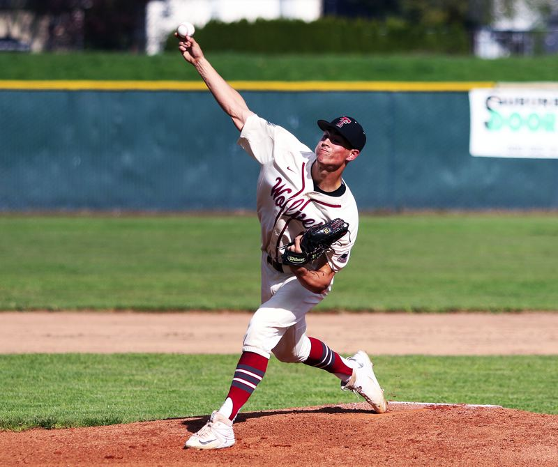 DAN BROOD - Tualatin senior Kaden Cook fires in a pitch during a game with West Linn last spring.