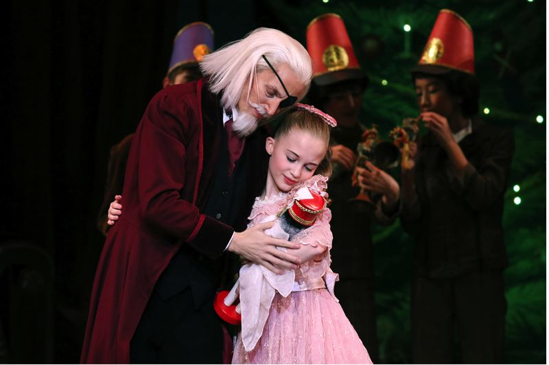 COURTESY: JAMES MCGREW - In the coming weeks a holiday highlight is 'The Nutcracker' by Oregon Ballet Theatre. Characters Herr Drosselmeier (played here by Chauncey Parsons) and Marie (Ruby Mae Lefebvre) are part of the show.