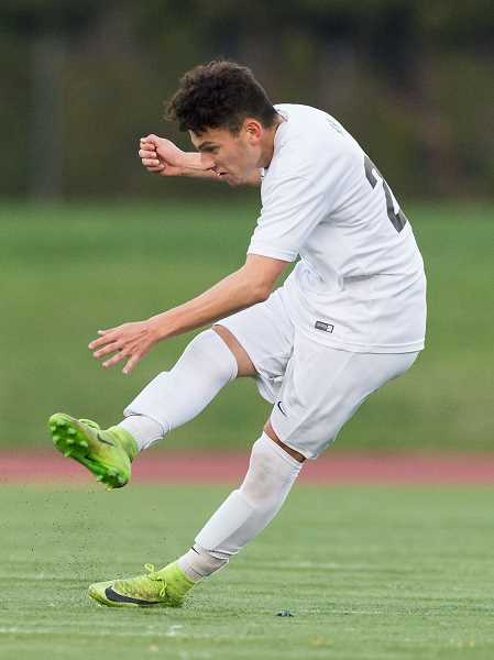 HILLSBORO TRIBUNE PHOTO: CHRISTOPHER OERTELL - Hilhi's Luis Mercado kicks the ball during a Spartans game earlier this season. Mercado was selected the NWOC Player of the Year.