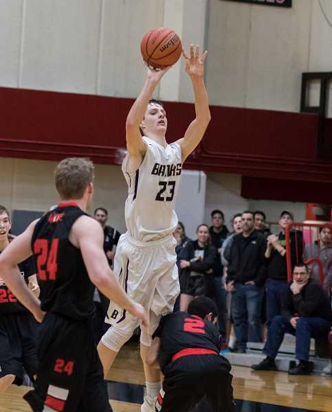 NEWS-TIMES FILE PHOTO - Banks' Dalton Renne takes a last second shot during the Braves' game in last year's state tournement versus Tillamook.