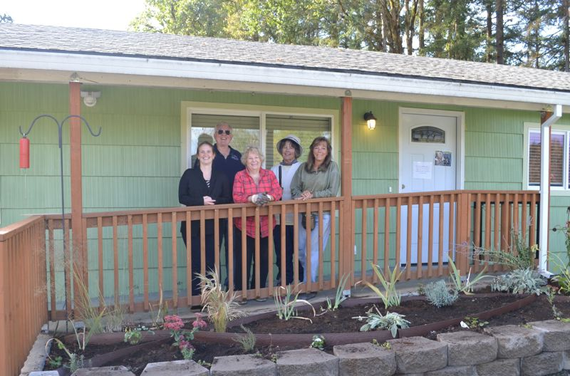 PHOTO COURTESY OF LYNN CHIOTTI - St. Helens Garden Club members Darlene Doris, Stan Chiotti, Nina Hogue, Pam Hess and Columbia Community Mental Health counselor Jill Vanwormer stand near the sensory garden at the Kids Haven counseling center in St. Helens.