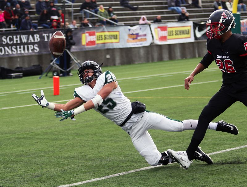 DAN BROOD - Tigard senior Braden Lenzy dives for the ball on a pass to the end zone during Friday's game.