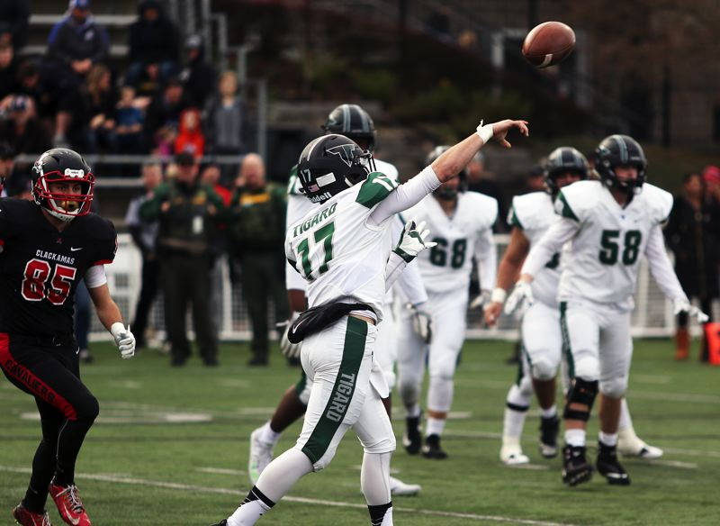 DAN BROOD - Tigard senior Michael Quintana throws a pass during the fourth quarter of Friay's state playoff semifinal game.