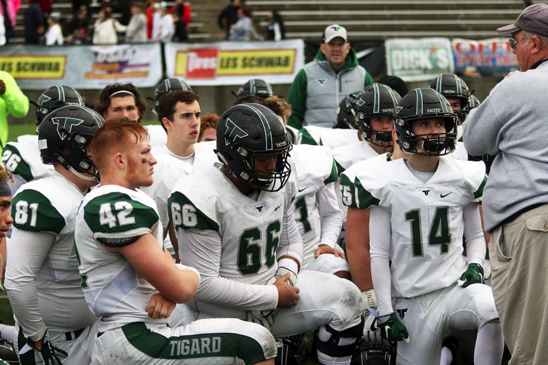 DAN BROOD - Tigard players listen to coach Craig Ruecker following Friday's state playoff semifinal contest.