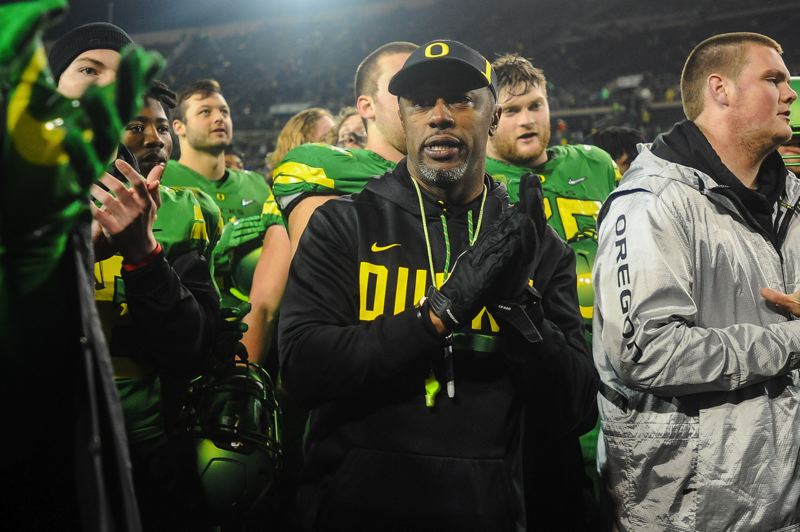 TRIBUNE PHOTO: JOSH KULLA  - Oregon coach Willie Taggart leaves the field after the Ducks' 69-10 victory over Oregon State on Saturday at Autzen Stadium.