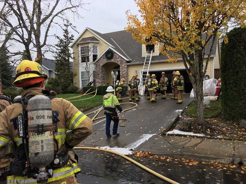 COURTESY TVF&R - Firefighters from Station 33 clean up following a fire Nov. 25 fire in Sherwood on Price Avenue.