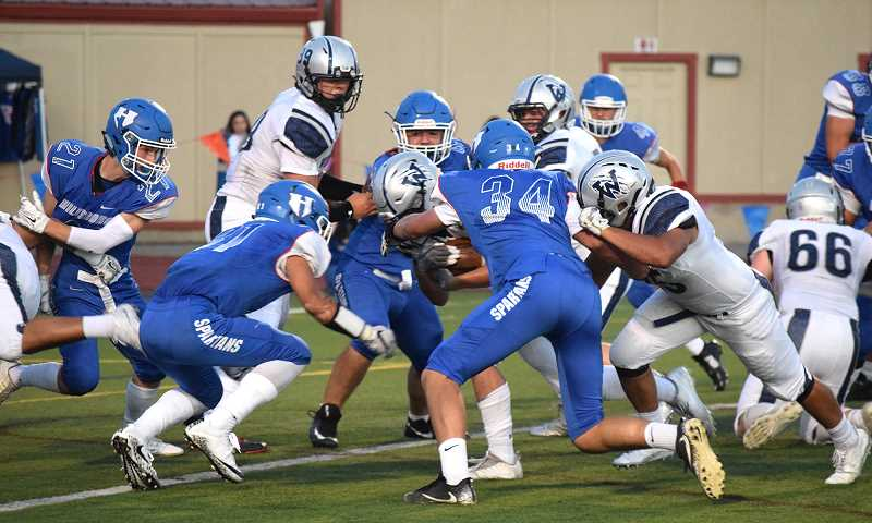 HILLSBORO TRIBUNE FILE PHOTO - The Hilhi Spartans battle in the trenches with the Wilsonville Wildcats during their game earlier this fall at Hare Field.