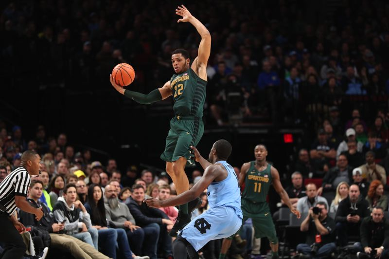 TRIBUNE PHOTO: JAIME VALDEZ - Miles Bridges of Michigan State goes up for the ball Sunday in a victory over North Carolina during the PK80 Invitational at Moda Center.