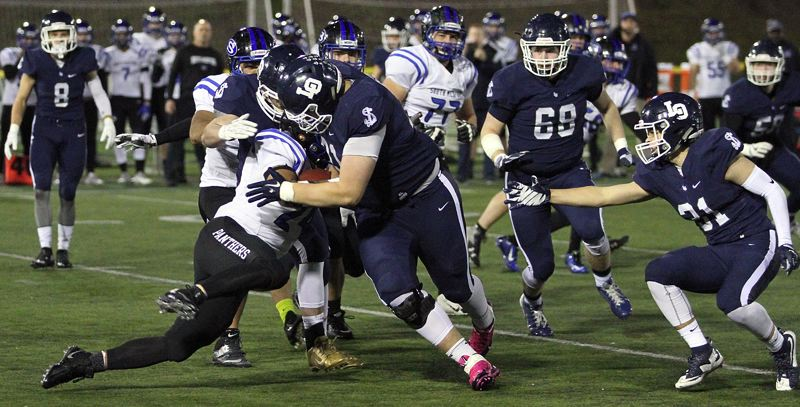 REVIEW PHOTO: MILES VANCE - Lake Oswego senior lineman Dawson Jaramillo (here making a stop against South Medford's Jaylin Parnell on Friday) and the Lakers lived up to the 'LO 48' motto all year, finishing as the best Laker team since 2012.