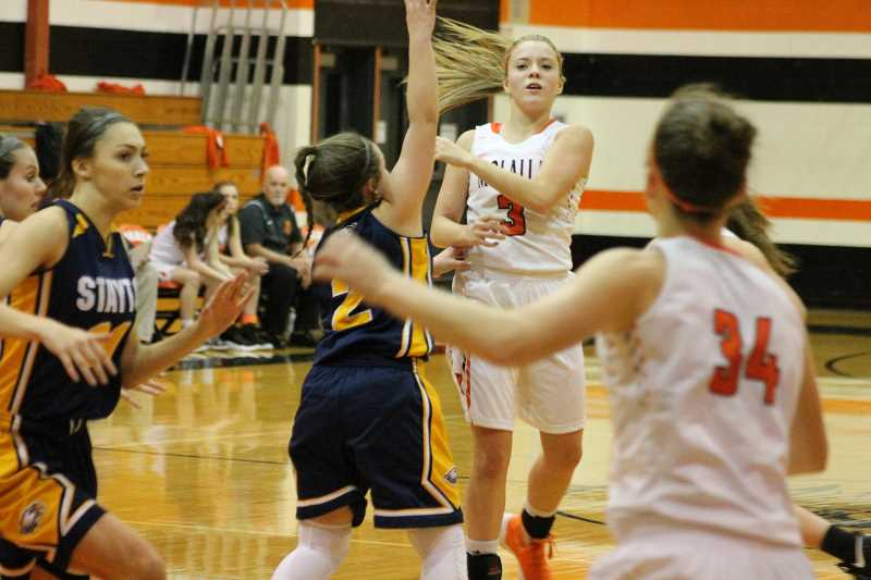 PIONEER PHOTO: CONNER WILLIAMS - Molalla senior Sierra Cox (3) passes to Alicia Schultz (34) during the Indians' home game against Stayton last season. Cox will again play a key role in the Indians' offense this season.