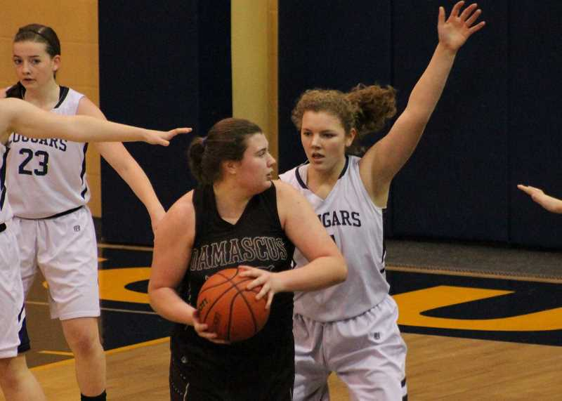PIONEER PHOTO: CONNER WILLIAMS - Country Christian senior Mollie Lewandowski guards a Damascus Christian player during the Cougars' 48-31 win last season.