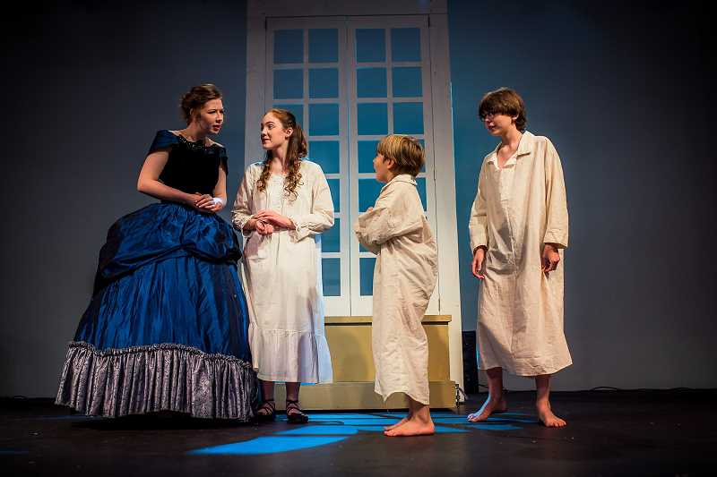 COURTESY PHOTO - Jessie Turner plays Mrs. Darling, Katrina Nix plays Wendy, Ezra Johnson plays Michael, and Daniel Johnson plays John in upcoming shows at The Chapel in Troutdale.