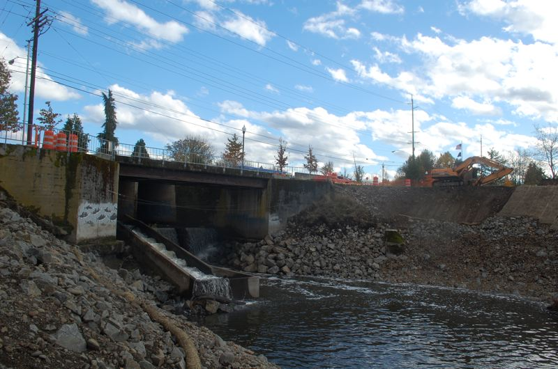 PHOTO BY: RAYMOND RENDLEMAN - Construction begins on the Kellogg Creek bridge, regrading the bank near the bridge and removing trees and other vegetation.