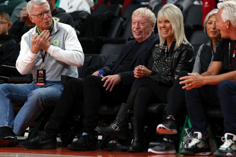 TRIBUNE PHOTO: JONATHAN HOUSE - Nike co-founder Phil Knight enjoys the basketball event named in his honor, PK80, at Moda Center.