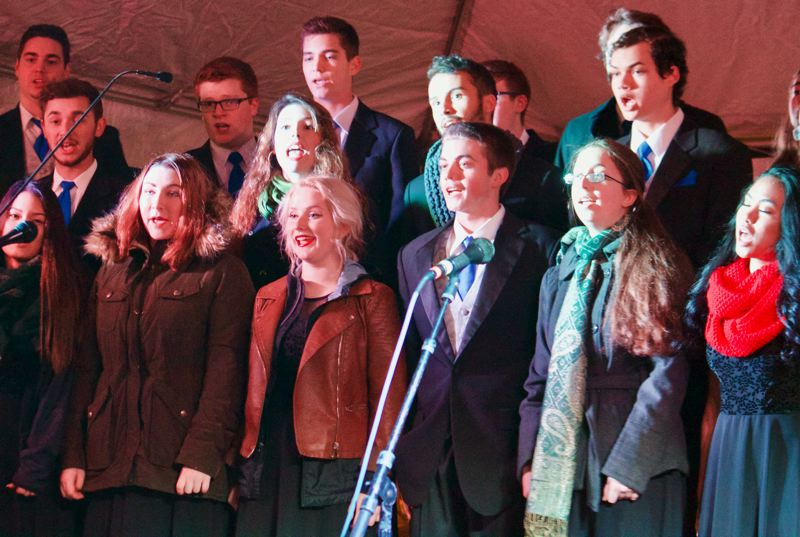 OUTLOOK PHOTO: CHRISTOPHER KEIZUR - The Gresham High School Overtones were one of the groups that sang Christmas songs on the main stage during the Spirit of Christmas.