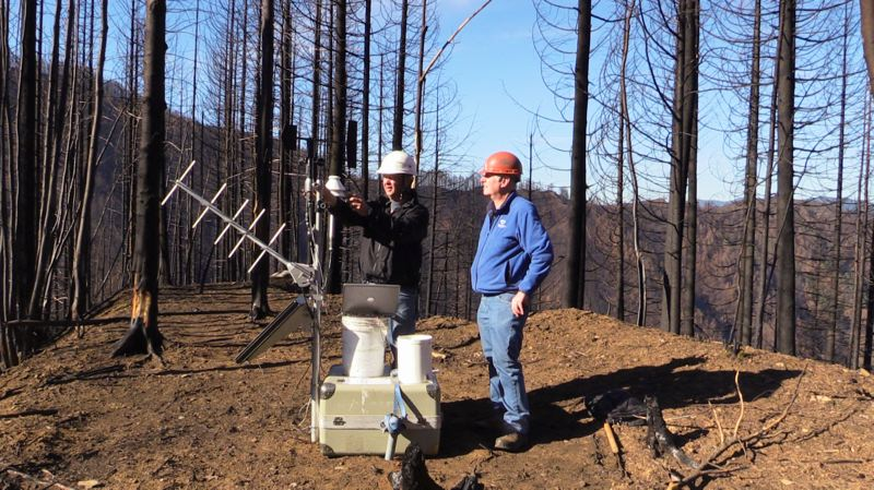 COURTESY U.S. FOREST SERVICE - Joe Hannon and Bill Schneider set up a remote weather station near the headwaters of Tanner Creek in the Columbia River Gorge.