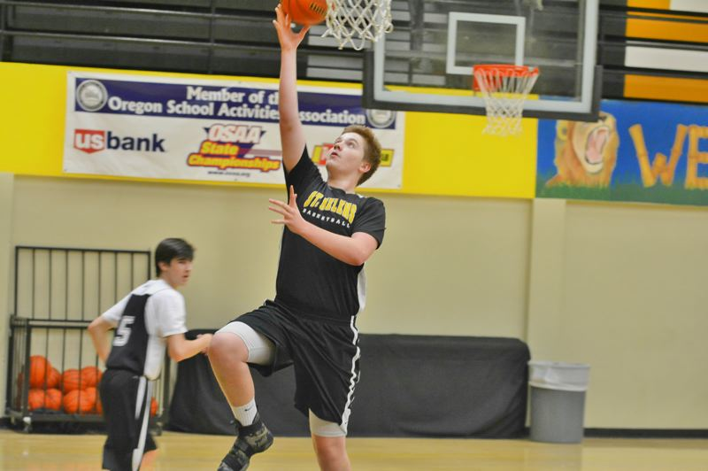 SPOTLIGHT PHOTO: JAKE MCNEAL - Parker Miller releases a layup in practice Tuesday, Nov. 21, at St. Helens High School.