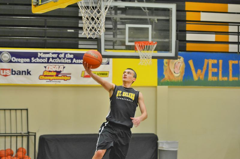 SPOTLIGHT PHOTO: JAKE MCNEAL - Jacob Robbins lifts for a layup in practice.