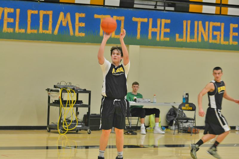 SPOTLIGHT PHOTO: JAKE MCNEAL - Joe Rea releases a jumper from the shoulder in practice.