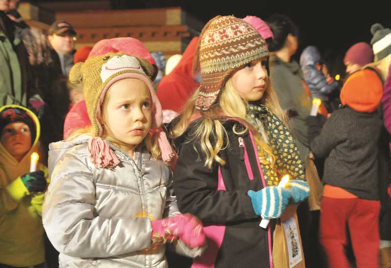 GRAPHIC FILE PHOTO - Youngsters anxiously await the arrival of Santa during last year's treelighting ceremony at the Chehalem Cultural Center.