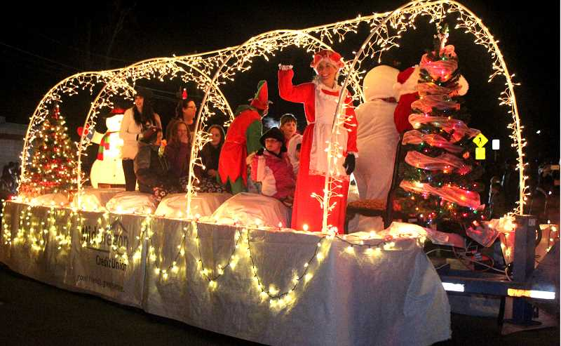FILE PHOTO - Lighted Christmas floats delight youngsters during the parade.