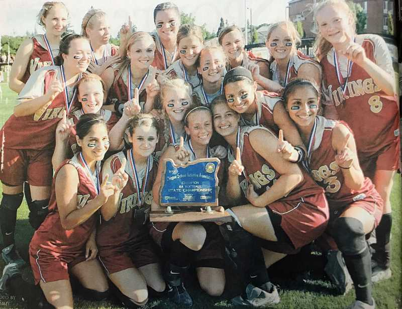 NEWS-TIMES FILE PHOTO - Members of the 2007 state championship softball team pose for a photo with the trophy following their win over Central Catholic.