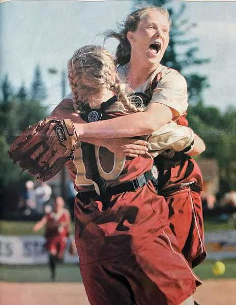 NEWS-TIMES FILE PHOTO - Forest Grove pitcher Emma Gronseth leaps into the arms of teammate Nikki Kemper after recording the final out of the 6A state championship game against Central Catholic in 2007.