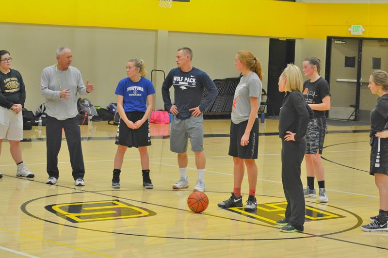 SPOTLIGHT PHOTO: JAKE MCNEAL - Assistant coach Tom Niebergall, left, stresses the importance of assertion on jump balls and tip-offs.