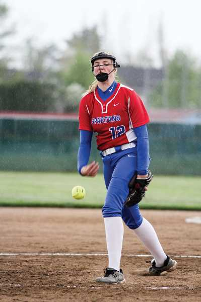 HILLSBORO TRIBUNE PHOTO: CHRISTOPHER OERTELL - Hilhi's Payton Goodrich delivers a pitch during a NWOC softball game against Milwaukie.
