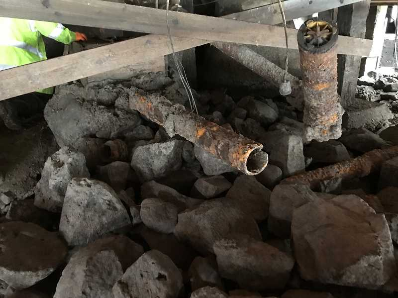 PHOTO COURTESY OF CITY OF LAKE OSWEGO - Inspectors discovered 10 broken or disconnected pipes under Cabana Pointe homes during the drawdown of Oswego Lake this month. Homeowners have been told to cap any abandoned lines and reconnect any plumbing as needed.