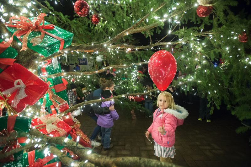 FILE PHOTO - Many different volunteers from local nonprofit groups and city staff bring Christmas cheer to Centennial Plaza every year. This year, the town Christmas tree will be lit at 7 p.m. Friday, Dec. 1.