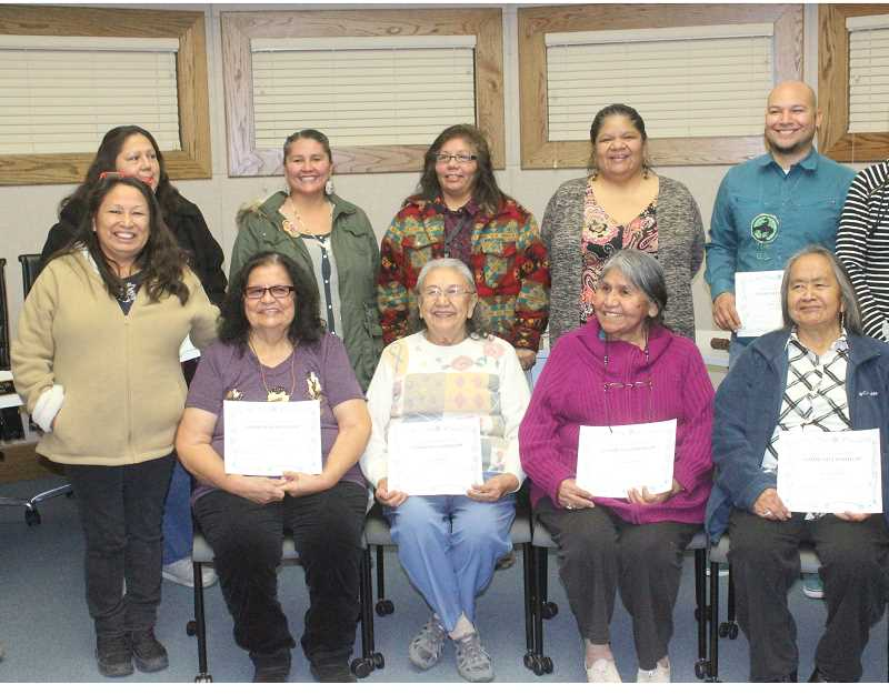 SUSAN MATHENY/MADRAS PIONEER - Native language teachers recognized at Monday night's 509-J board meeting included, from front left, Warm Springs Culture and Heritage Director Valerie Switzler, Orthelia Patt, Arlita Rhoan, Viola Govenor, and Suzie Slockish. Back left, Pam Cardenas, Merle Kirk, Deanni Johnson, Deanie Smith and Jefferson Greene.