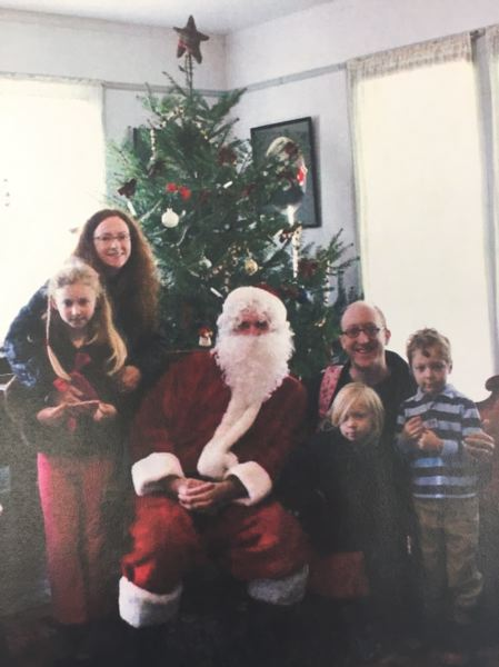 CONTRIBUTED PHOTO: JENNIFER GOLDMAN - A family enjoys a visit with Santa at Philip Foster Farms Christmas in the County.