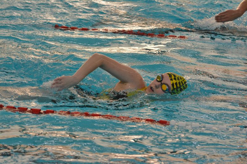 SPOTLIGHT PHOTO: JAKE MCNEAL - Audra Lein swims the freestyle.