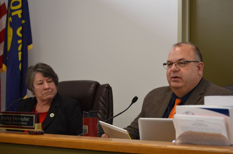 SPOTLIGHT PHOTO: COURTNEY VAUGHN - Columbia County Commissioners Margaret Magruder (left) and Henry Heimuller comment on their votes to approve a rezone of farmland in Clatskanie for the expansion of Port Westward.