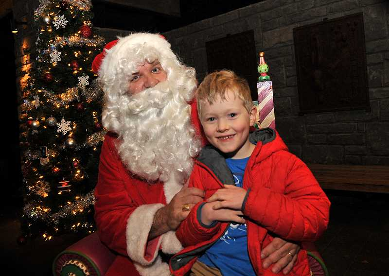 Sean OConnor visits with Santa on gives him his wish list.