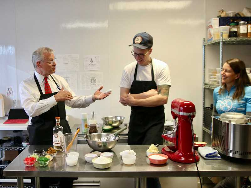 SUBMITTED PHOTOS: ALISON JONES, SALT & STRAW - U.S. Rep. Earl Blumenauer (from left) and Tyler Malek of Salt & Straw prepare Blumenauers fruitcake, which is combined with Salt & Straws salted vanilla ice cream to make a tasty treat that benefits Community Cycling Center through the month of December. At right is Kasandra Griffin, executive director of Community Cycling Center, a nonprofit organization that believes bikes play a role in creating a healthy, vibrant and connected city.