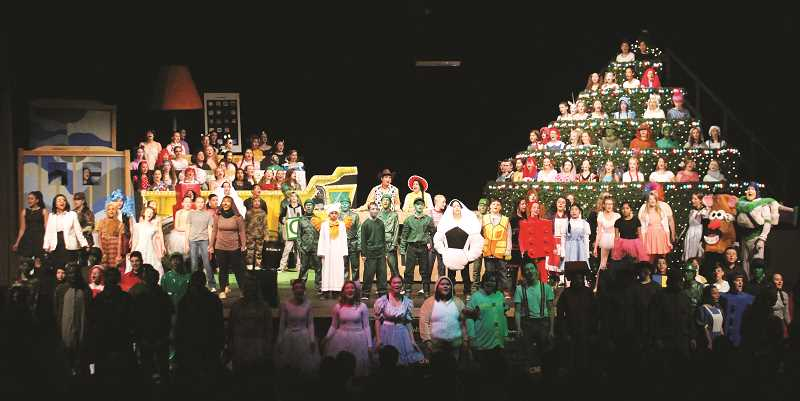 PIONEER FILE PHOTO - Molalla Singing Christmas Tree dives under the sea at the high school auditorium on Dec. 7-9. Pictured is the 2016 Molalla Singing Christmas Tree.