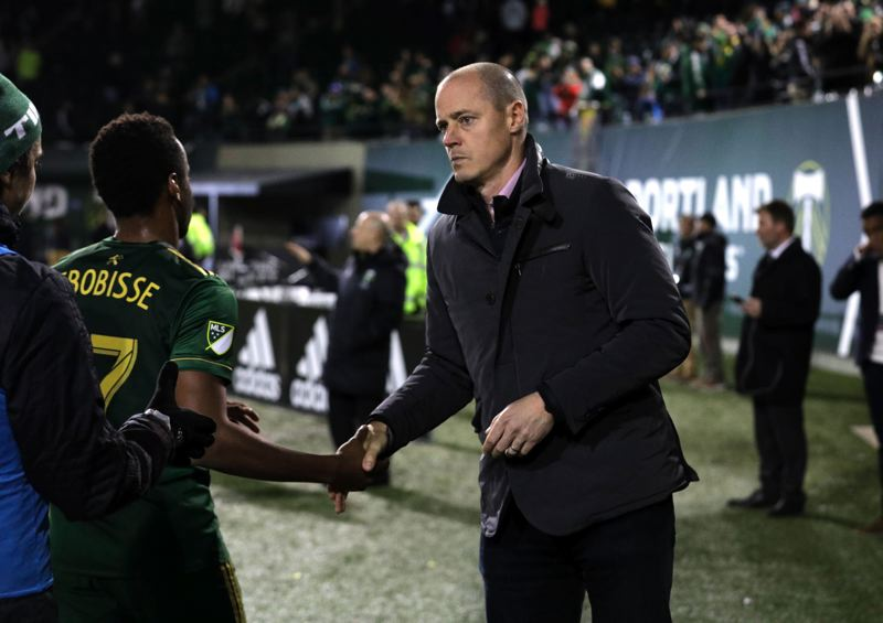 TRIBUNE PHOTO: JONATHAN HOUSE - Portland Timbers owner Merritt Paulson greets players after the team's ouster from the 2017 MLS playoffs.
