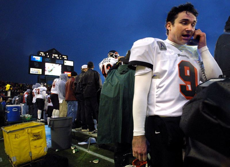 TRIBUNE FILE PHOTO: L.E. BASKOW - In the 2001 Civil War, Oregon State quarterback Jonathan Smith talks with coaches upstairs.