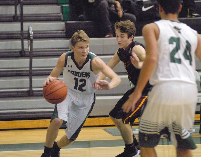 GRESHAM OUTLOOK: MATT RAWLINGS - Reynolds point guard Cal Reiss drives past a defender.