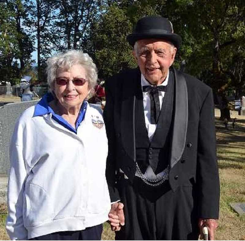 COURTESY PHOTO - Robert Nixon with his wife Jean pose for a photo at Mountain View Cemetery in Forest Grove during an interactive tour centered around pioneers buried at the site. Nixon acted in the production.