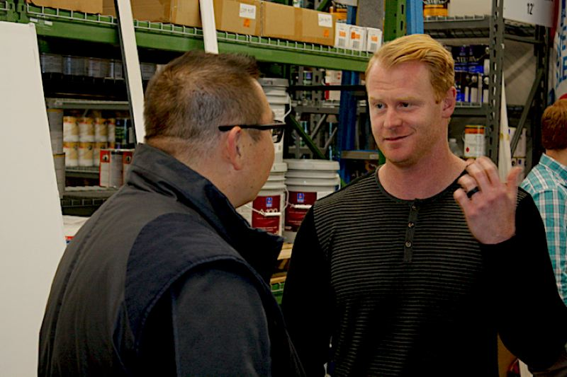 OUTLOOK PHOTO: STEVEN BROWN - Brian York, left, marketing specialist with Clackamas County Bank, visits with Seattle Seahawks punter Jon Ryan.