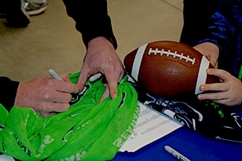 OUTLOOK PHOTO: STEVEN BROWN - Seattle Seahawks punter Jon Ryan signs an autograph during a Gresham Chamber of Commerce Try Local Tuesday event.