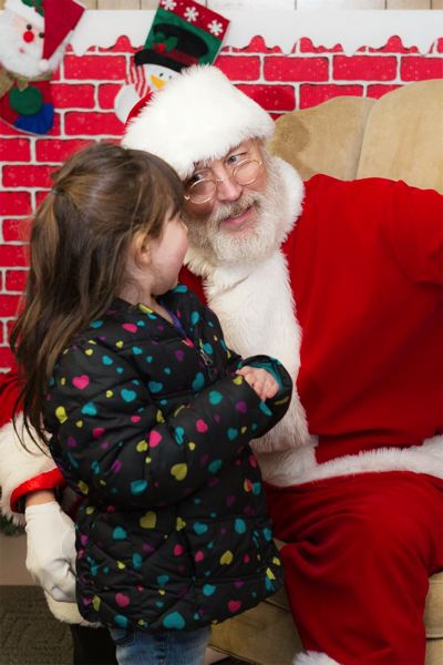 FILE PHOTO - Hundreds of children have flocked to the winter event over the years, eagerly waiting in line to get their photo taken with Mr. Claus and give him their hand-crafted letters.