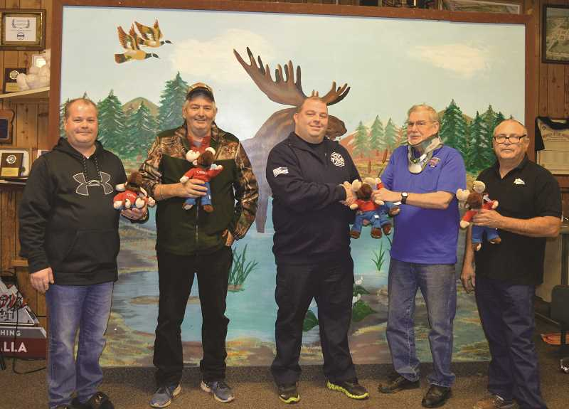 PIONEER PHOTO: CINDY FAMA - The Molalla Moose Lodge donated stuffed animals to Colton Fire. Pictured from left to right are: Brent Hill, Richard LeGore, Lt. Chris Colhoon of Colton Fire, Richard Townsend and Rick Reed.