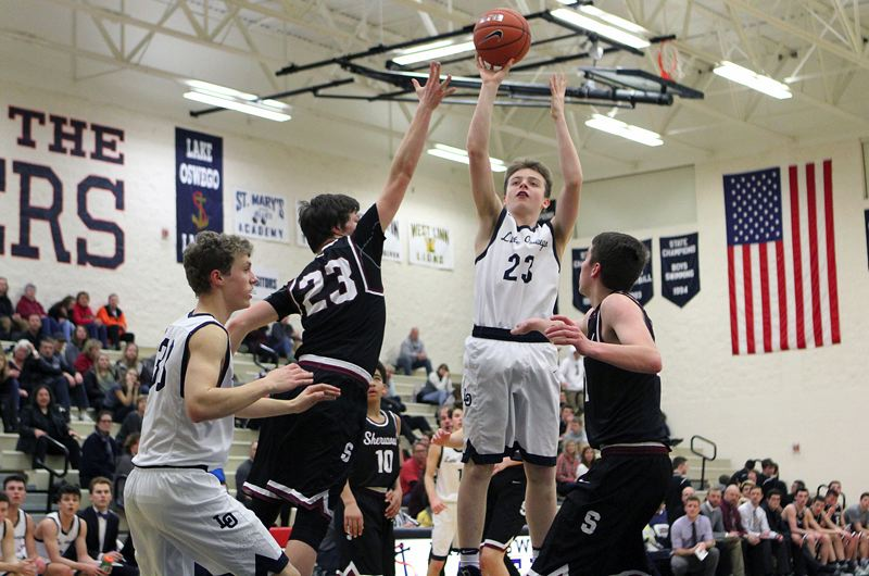 REVIEW PHOTO: MILES VANCE - Lake Oswego junior guard Josh Angle is back to lead the Lakers after earning honorable mention all-Three Rivers League honors a year ago.